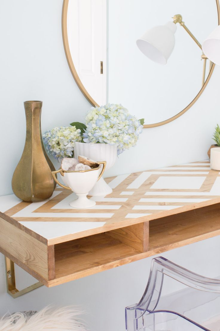 Erin is sharing a tutorial for this DIY floating desk she built for the FrogTape…