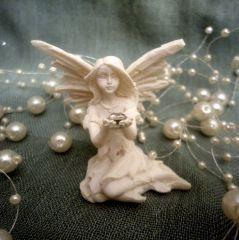 Mini melek biblo Ölçüler: 4 cm x 4,5 cm