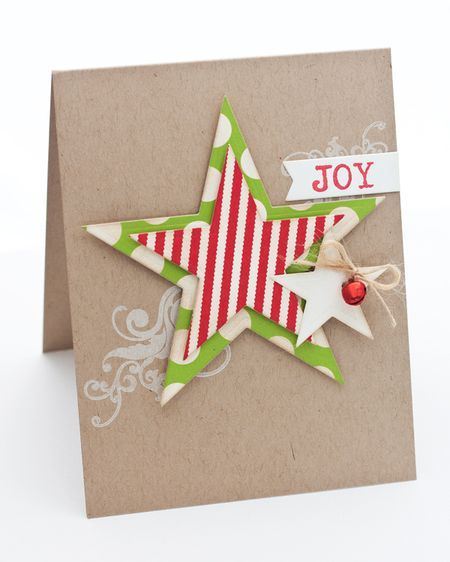 "Star cuts from ""My Favorite Things"" add the color pops to the kraft base on this handmade Christmas card.  Create the word JOY with the typewrite alphabet font and add a simple white flourish."