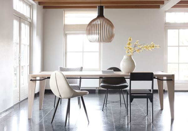 Our Octo 4240 pendant with black laminated finish in a bright and airy interior.