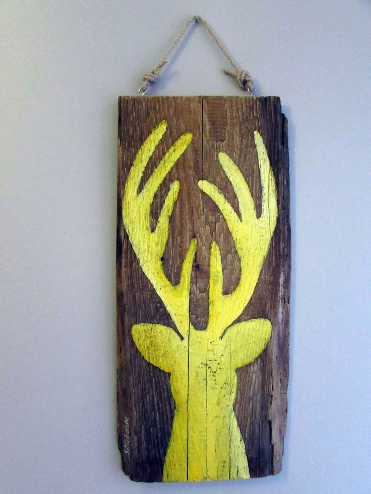 kolorowe jelenie na starych deskach by Sylwia Michalska