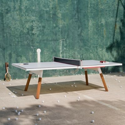 More than just a pretty tennis table, the Outdoor Ping-Pong Table is a multifunctional addition to your patio. Save valuable outdoor space by converting    the tennis table into a large dining table, conference table, or general use side table. Simply tuck the net, paddles and balls into the side drawer,    hidden away completely. A high-quality steel frame ensures durability, while slanted iroko wood legs lend to midcentury modern styling. Whether you are    serving a Ping-Pong ball or ...