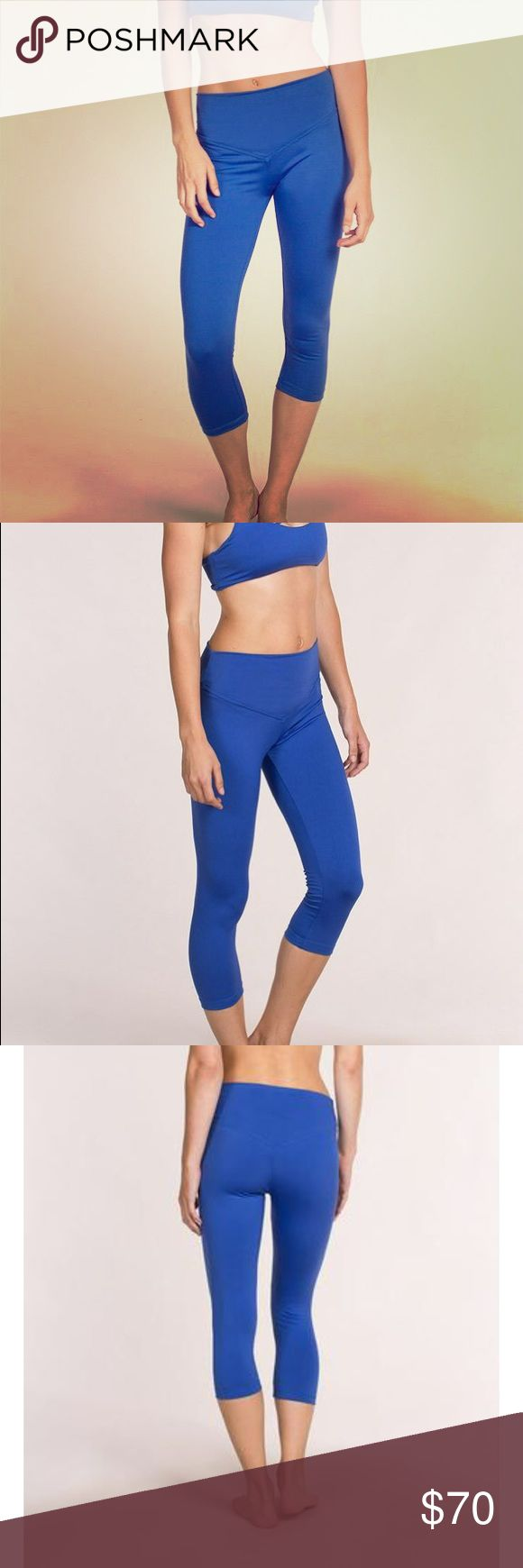 "Olympia Activewear Mateo Cerulean legging NWT Mateo 3/4 length Olympia legging in Cerulean, very comfortable, pretty color, size medium. Model is 5""9 and wearing a size small. Olympia Activewear Pants Leggings"