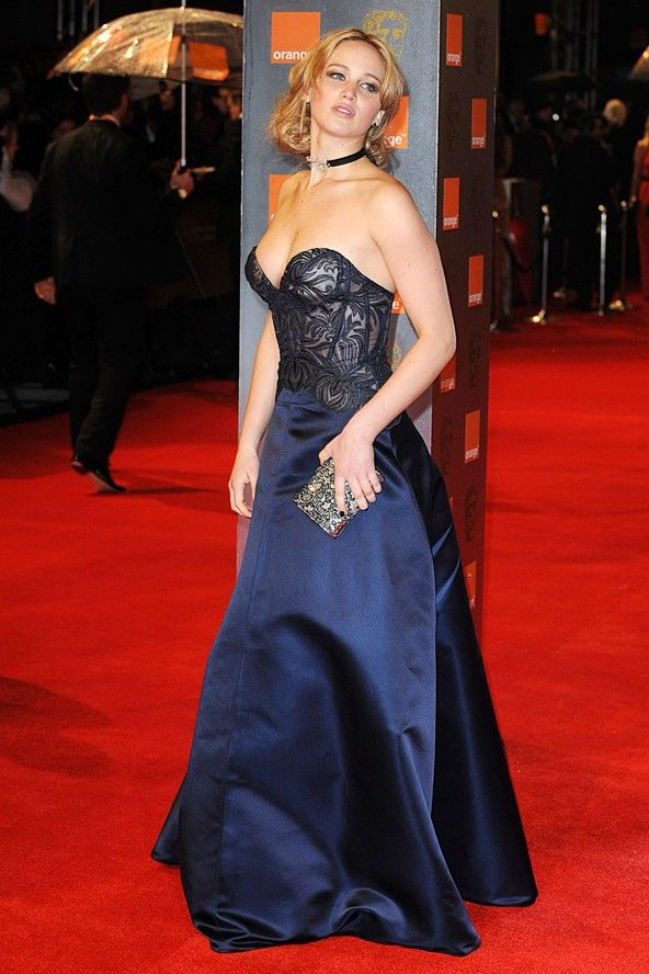 Jennifer Lawrence wore a plunging strapless  dress by Stella McCartney.