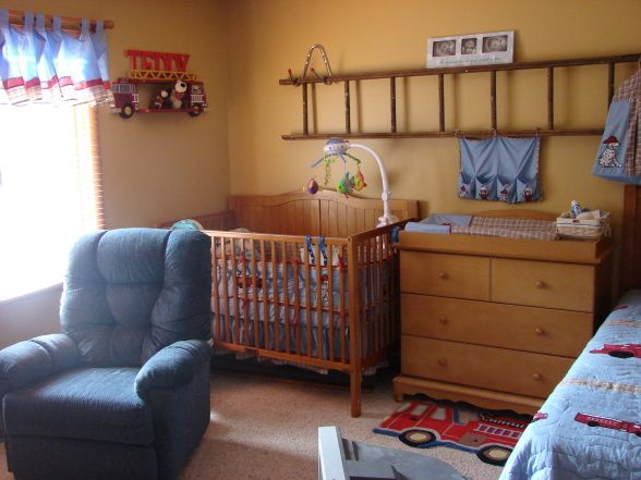 I love the ladder on the wall... I love this room for a little boys room!