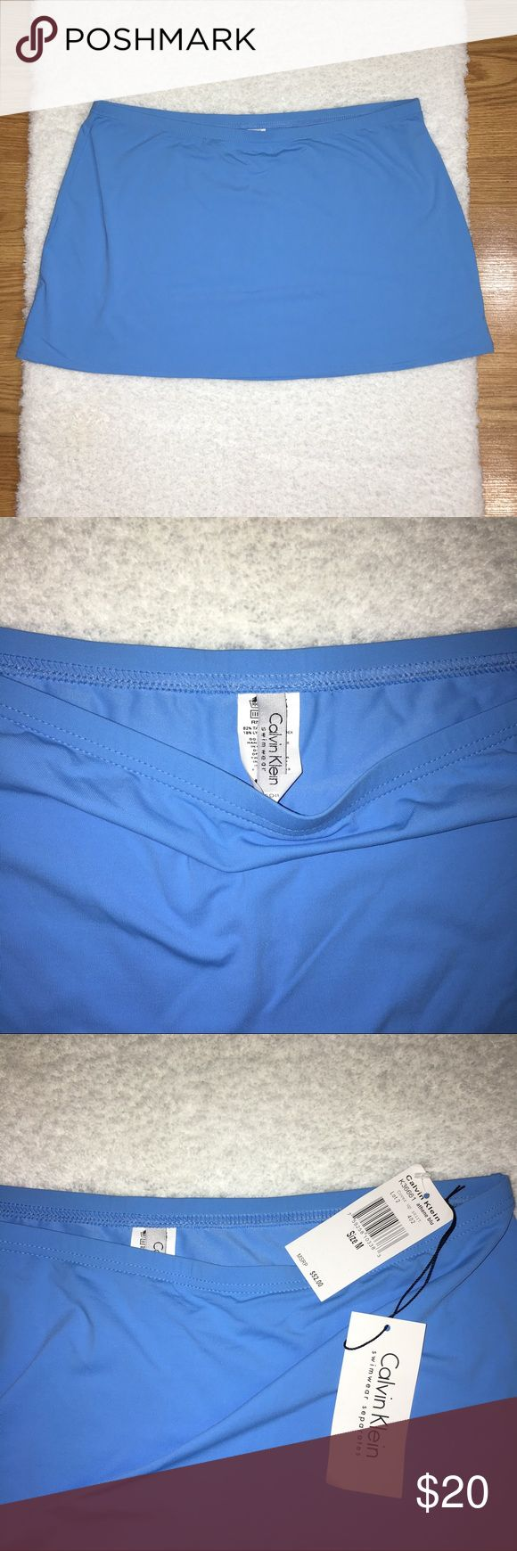 Calvin Klein Cover up Skirt Size Medium, waist: 30' length: 12.5' has a small mark on the inside of Skirt shown in picture, 82% tactless nylon 18% Lycra spandex NWT in good condition never worn Calvin Klein Swim Coverups