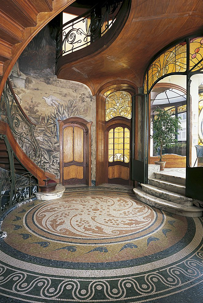 This art nouveau hotel is a good representation of the art nouveau style, the main focus not being on furniture but on the art covering the walls and she shapes created in the staircase. The art mainly derived from nature as you can see the walls are covered in leaves, birds and landscapes.