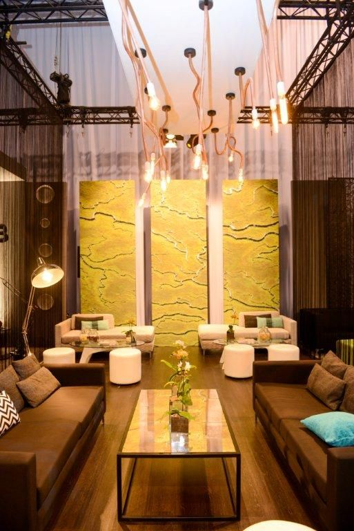 Copper piping light bulbs & bespoke furniture wrapped graphic panels & spaghetti curtainung