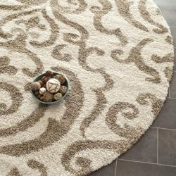 @Overstock - This beige and cream shag rug is a stylish addition to your room. The rugs neutral colors easily complement any decor, and its high-density polypropylene construction gives it extra plushness. It features a beige pattern on a solid cream background.http://www.overstock.com/Home-Garden/Ultimate-Cream-Beige-Shag-Rug-6-7-Round/6372278/product.html?CID=214117 $143.99