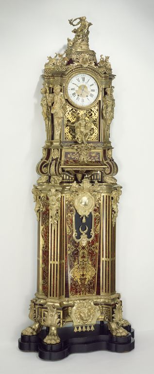 Long-case Musical Clock; Clock movement by Jean-François Dominicé (French, 1694 - after 1754), musical movement by Michel Stollenwerck (German, about 1700 - 1768, master 1746), clock case attributed to Alexandre-Jean Oppenordt (French, 1639 - 1715), et al; Paris, France; about 1712; Veneered with brass and tortoise shell on oak carcass: bronze mounts, enameled metal; glass; 266.7 x 104.1 x 39.4 cm (105 x 41 x 15 1/2 in.); 72.DB.40