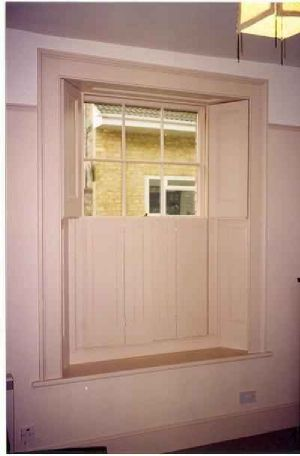One piece wooden shutters - inspiration for dressing triple aspect Victorian Lounge sash windows...