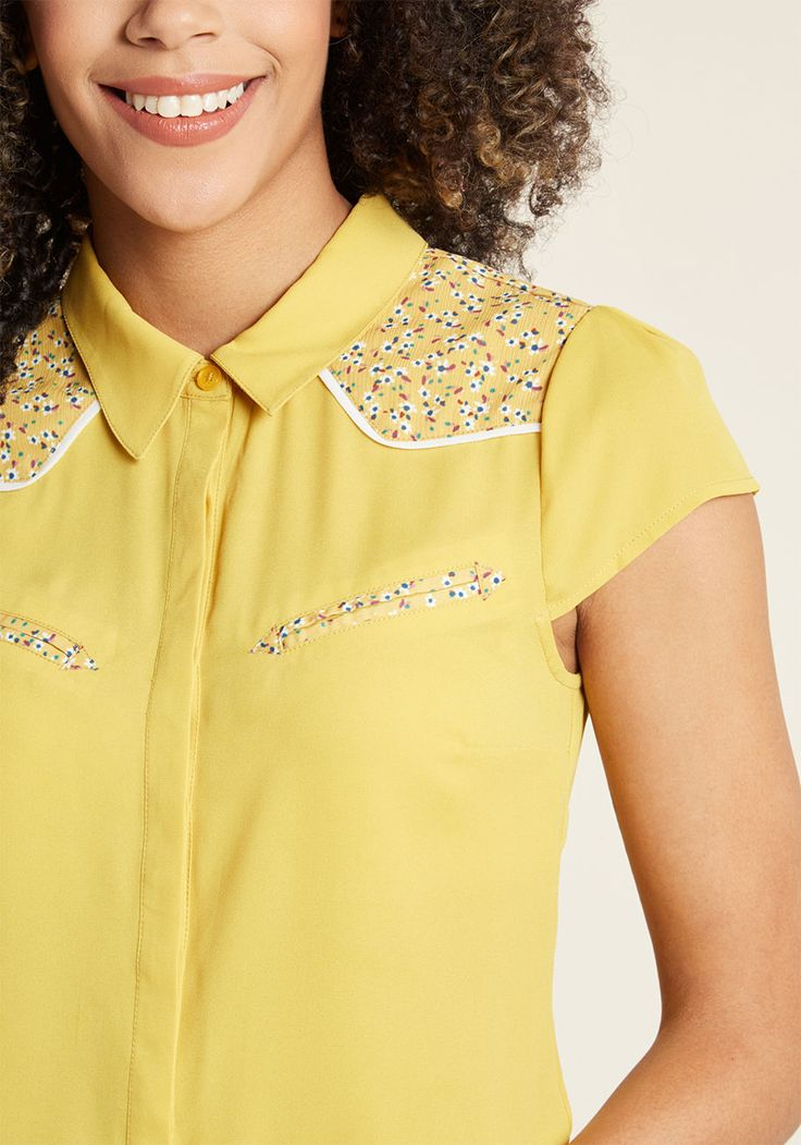 """Western Whimsy Button-Up Top - With a westerly emphasis, this yellow blouse from our ModCloth namesake label says """"howdy"""" to sartorial know-how! A collar, floral-printed shoulders, and faux chest pockets nod to old school excellence, while a hidden button placket, puckered cap sleeves, and darting have the makings of a modern fit with loads of moxie."""