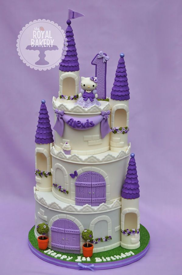"A castle cake for Alexis' first birthday.    The cake is based on a two-tier version by Yummy Cupcakes, which I just loved, and I added the turrets after seeing Dulcie Blue Bakery's version of that same cake.    The tier sizes are 9"", 7"" and 5"" and I will be writing a tutorial for my Facebook Page very soon.     Thank you for looking!"