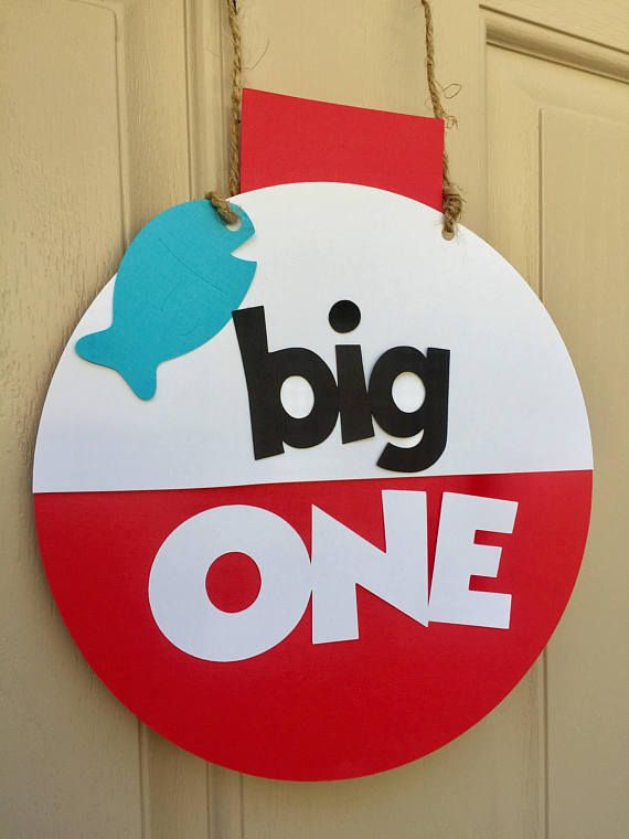 The Big One fishing themed package includes: -ONE banner with fish and bobber on each side. Each section measures 5.25 inches, coordinated 2 foot fabric strip banner. -$35.00 -Sign: Measures about 9 inches wide and 11 inches tall ( from top of bobber to bottom). -$10.00 -3