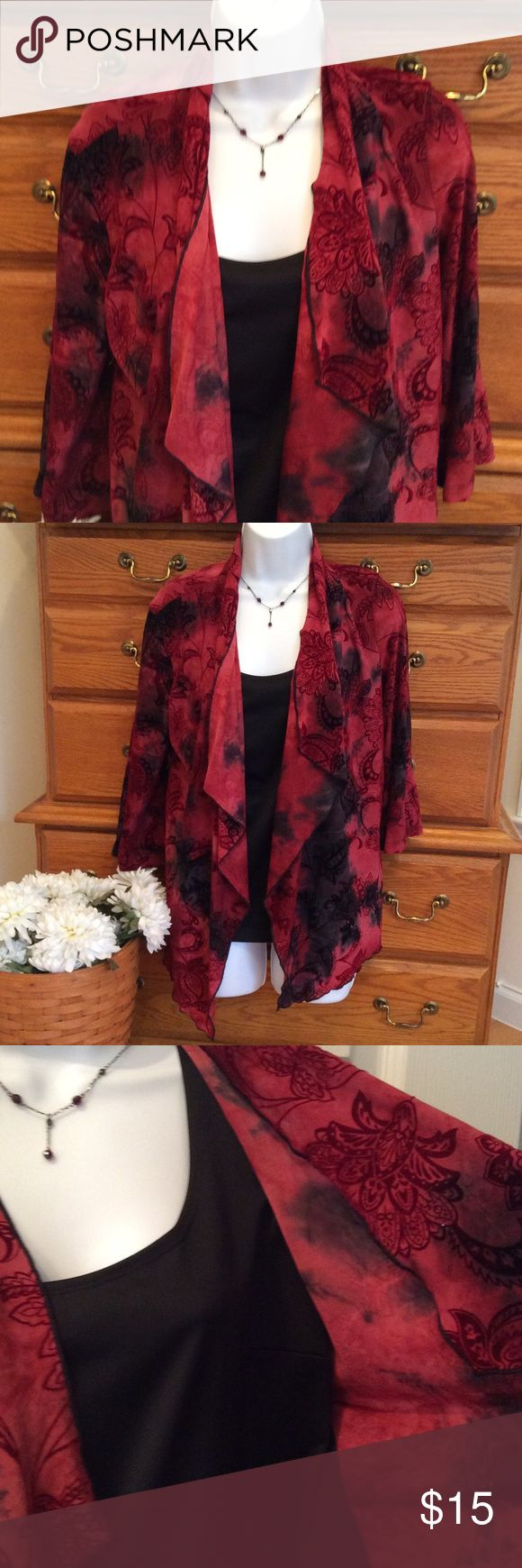 """Dress Barn One Piece Blouse With Cardigans Polyester, nylon and spandex. EUC.  Colors are black, reds, and a dark purple with a touch of velvet on the flowers and leaves.  Approximately 24"""" in length but the front jacket is several inches longer in the front.. When laid flat and measured from armpit to armpit it is 20"""" across.   It is all in one as I tried to show in the third picture.  It is Petite Large. Dress Barn Tops Blouses"""