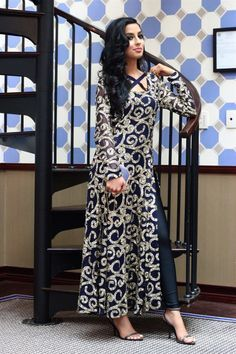 AnnieSwift in a glittery navy blue dress