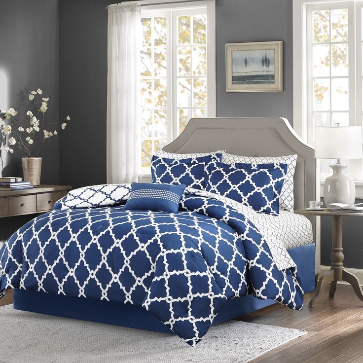 The Madison Park Essentials Cole Complete Bed and Sheet Set creates a simple yet chic look in your space. The fretwork design creates a modern look with its white design on a bold navy base.