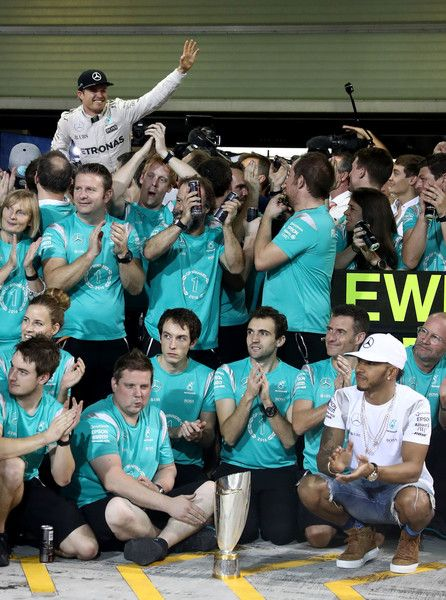 - Nico Rosberg of Germany and Mercedes GP is carried to the team celebration shot as Lewis Hamilton of Great Britain and Mercedes GP applauds him during the Abu Dhabi Formula One Grand Prix at Yas Marina Circuit on November 27, 2016 in Abu Dhabi, United Arab Emirates. - F1 Grand Prix of Abu Dhabi