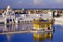Amritsar, Punjab, India     The holiest site in Sikhism, the Golden Temple seems to float on the water. It enshrines the holy book, Guru Granth Sahib, which is venerated by pilgrims throughout the day and put to bed at night.