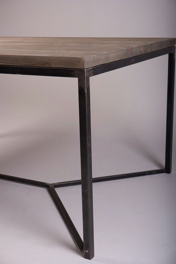 Solid Industrial Dining Table with V framed steel legs. Handcrafted of solid reclaimed pine timbers from 100-year old buildings, our inspired table