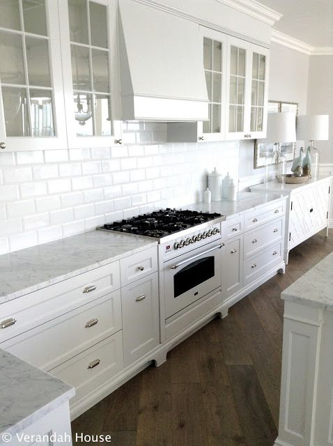 Love the white cabinets, and the glass door ones.  The white marble looks very clean and sleek.