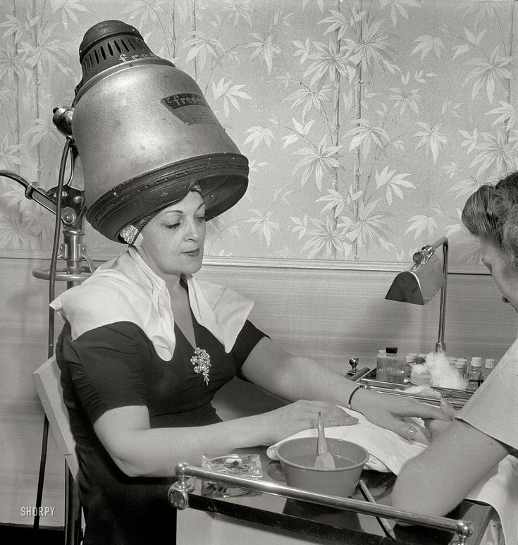 """September 1942. """"New York, New York. Getting a manicure while drying hair at Francois de Paris, a hairdresser on West Eighth Street."""""""