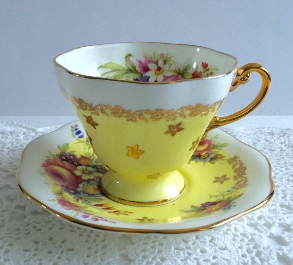 Vintage E.B Foley china tea cup and saucer, made in England. An absolutely stunning set, yellow and white with lovely hand painted pink, purple white and yellow flowers. It is in good condition, no chips, cracks, crazing or repairs. Both pieces ring nicely    Please Note: The items I sell are not new, they are vintage or antiques, it goes without saying that there maybe some imperfections which I will try my best to point out and take pictures of.  I do not look at my items under a…