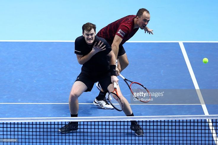 Bruno Soares of Brazil hits a return next to his partner Jamie Murray of Great Britain during their men's doubles match against Mike Bryan of the United States and Bob Bryan of the United States on day three of the ATP World Tour Finals at O2 Arena on November 15, 2016 in London, England.  (Photo by Clive Brunskill/Getty Images)