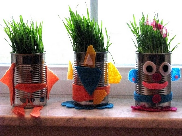 Tin can grass heads, we already do this idea but with Styrofoam cups.  I love the idea of having the kiddos recycle a can from home and lets be honest this little guy is much cuter in a can than in a cup!  Love it!