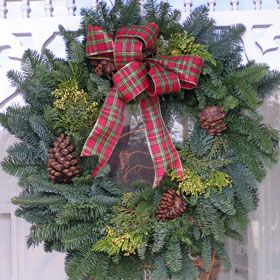 Beautiful Oregon noble fir Christmas wreath, thick, fragrant fresh forest scent. 22'' to 24'' around, handmade and decorated wreath with pine cones, noble fir greens, incense cedar, blue juniper berries, plaid french wire bow. WR120. Gift boxed with a beautiful Pumpernickel Press gift card,