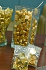 Gold wrapped candy in clear, glass vase, great idea for purposeful decoration for various holidays, just keep extra bags of candy to keep it full - Hershey's Kisses or Red Hots for Valentine!s Day, Robin's Eggs for Easter, Candy Corn for Fall, etc.
