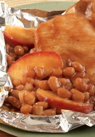 Pork Chop-Apple-Bean Packets...Have fun outside by the grill this summer with these easy to construct aluminum packets. The flavors from the pork, red apples, onion and barbecue sauce will steam inside the packets and give you a savory taste when you open