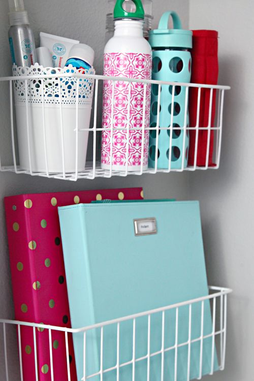 Install bins in the wall of a coat closet, use one to store frequently used notebooks or binders and the other for water bottles and outdoor potions