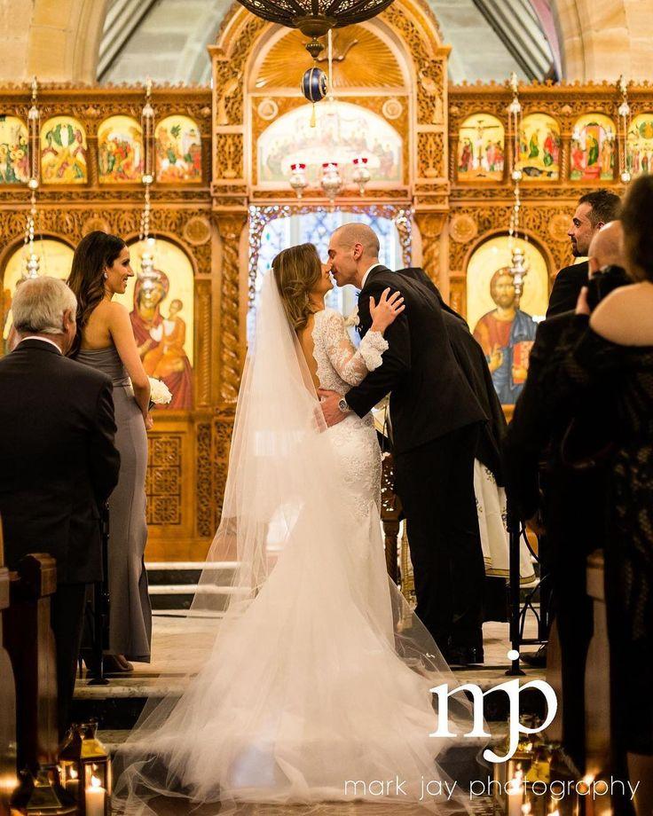 Daniel  Theodora // First kiss as husband and wife  #weddingdress @bizzaro_bridal_couture  #hair @cheveux_hair_and_beauty  #makeup @makeupbyanastasia  #earrings @nomikiglynatsis  #flowers @sydneyweddingflowers  #weddingvideo @cinemotive