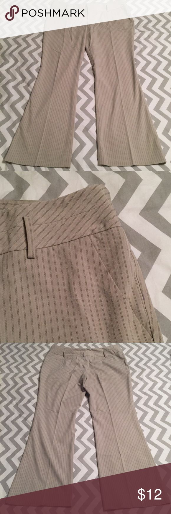 Mossimo Pinstripe Pants Khaki colored dress pants with brown pinstripe running through. Side slant pockets and back welt pockets. Wide waist loops to accommodate any size belt. Waist is 20, inseam 31. These are in EUC. Mossimo Supply Co. Pants Trousers
