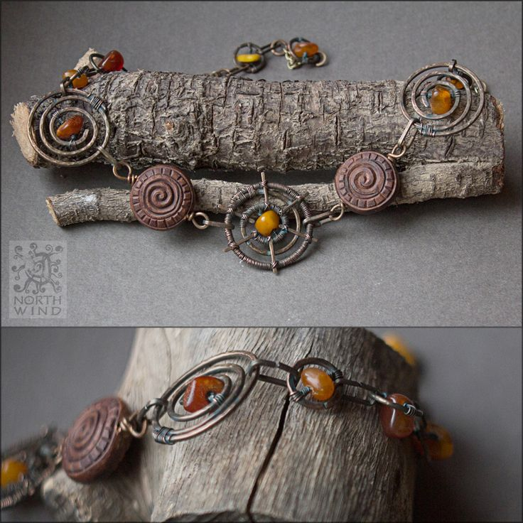 Three Suns Necklace Heavy tribal-style necklace, made of hand crafted ceramic beads, patinated copper wire & amber.