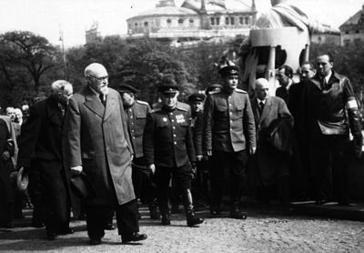 Karl Renner walking to the Parliament building, flanked by Soviet officers, Vienna, Austria, 29 Apr 1945
