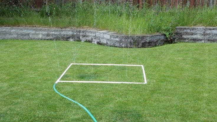 Homemade sprinkler. Made from PVC pipe, elbows, hose to pipe connector, pvc cement and a drill to make holes.