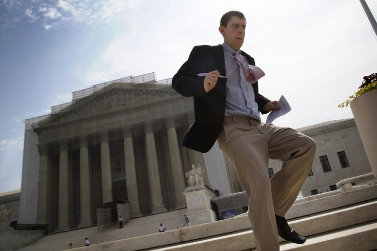 BREAKING NEWS: A television-news producer sprinted from the Supreme Court in Washington, D.C., Monday, delivering word that the court had sidestepped a ruling on affirmative action, directing lower courts to re-examine a race-conscious admissions program at the University of Texas at Austin. (Jonathan Ernst/Reuters)