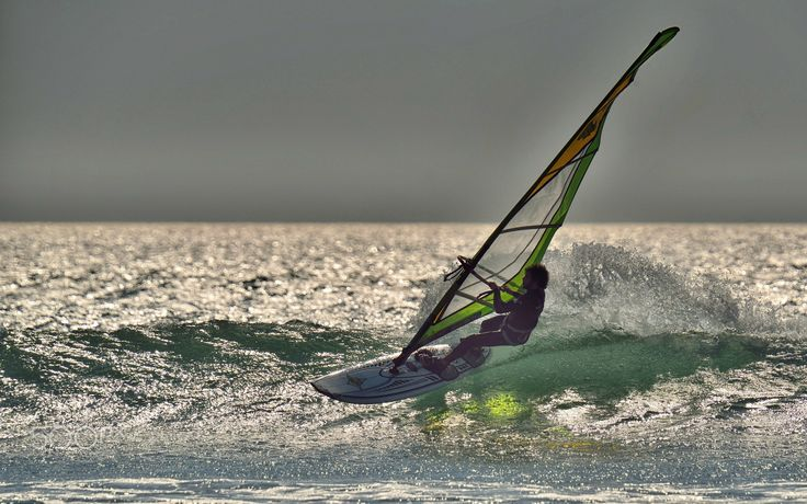 Summertime fun - Riding some small waves on a windsurfboard in summer is still fun!
