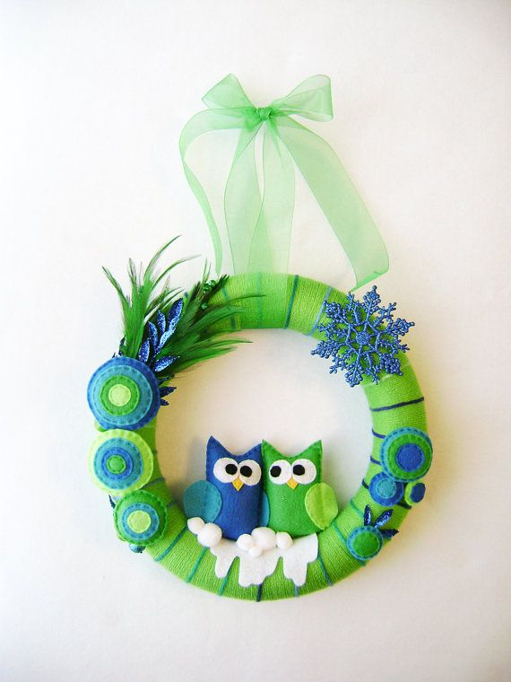 Yarn and Felt Wreath - Peacock Christmas - Owl Blue Green. $75.00, via Etsy.