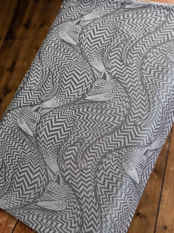 Ecru and dove grey combine for a gorgeous monochrome wrap featuring our geometric fox design.   Woven with organic combed cotton for softness and strength