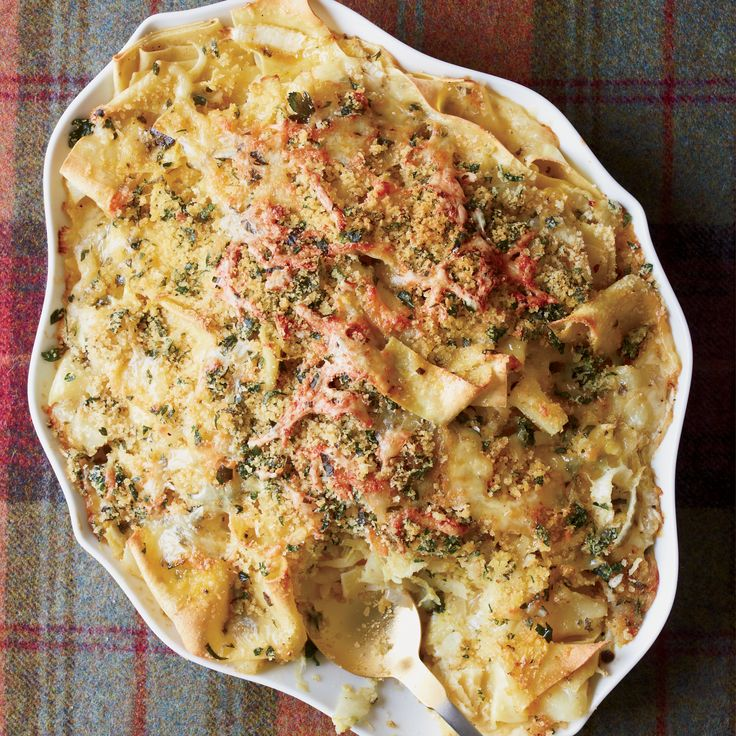 This is the ultimate comfort food: tender noodles mixed with potatoes and cabbage, then baked with cheese and a crispy bread-crumb topping.