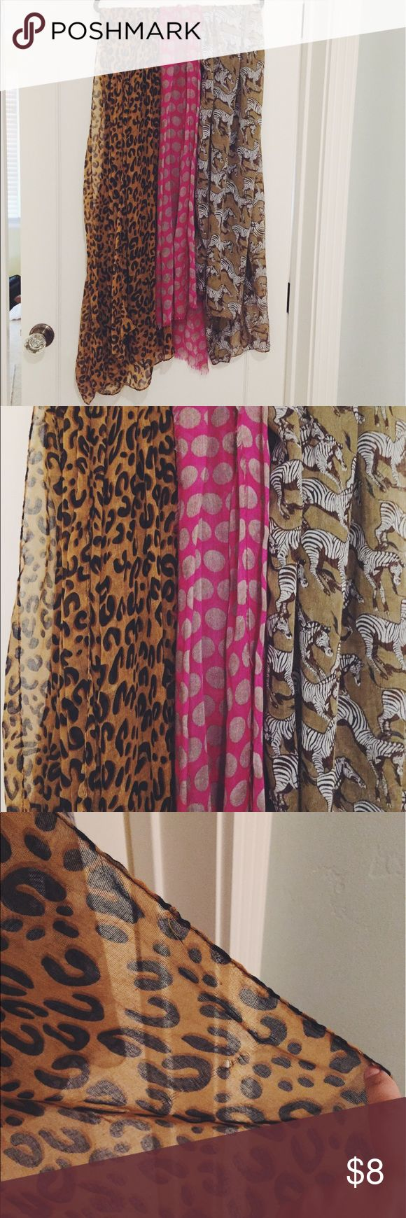 Chiffon print scarves Pretty and light scarves. Perfect for spring and fall! Price is for one scarf. Please comment when you order to specify which one you would like! Cheetah (L), dots (middle), or zebras (R). Please note cheetah scarf has a small hole. Offers welcome! Accessories Scarves & Wraps