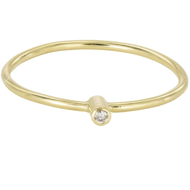 An elegant minimalistic stacking ring in 18k gold, with a 1.5mm diamond. Wear it naturally, simply and happy. A diamond is forever but also for every day! The diamond sparkle is utterly unmistakable.
