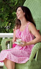 The 'Violet' nighty in pink falls to the knee and has a scalloped neckline and armholes. A pink cotton twill ribbon fastens the neck and a single mother of pearl button adorns the shoulders.  http://www.aprilcornell.com/product/Violet-Ladies-Nighty-NTA5261W-Pink/nightwear