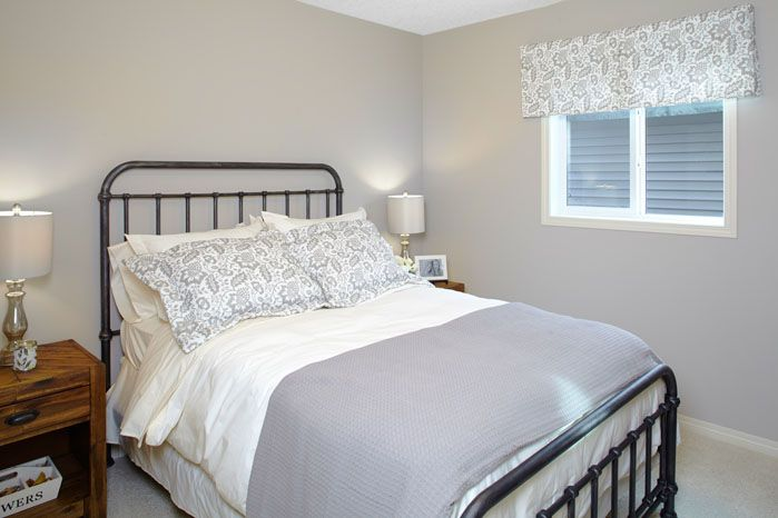 Spare bedroom in the Orion II showhome in King's Heights in Airdrie by Shane Homes.