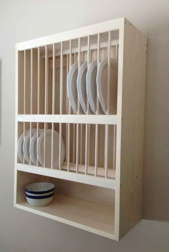 This wall hanging plate rack has a top row for 12 large plates, lower row for 12 smaller plates, and a lower shelf for mugs, bowls, small plates, etc. Have