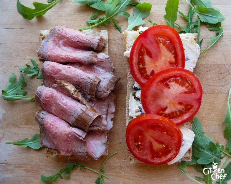 ... sliced steak with arugula salad in plate elevated view sliced steak