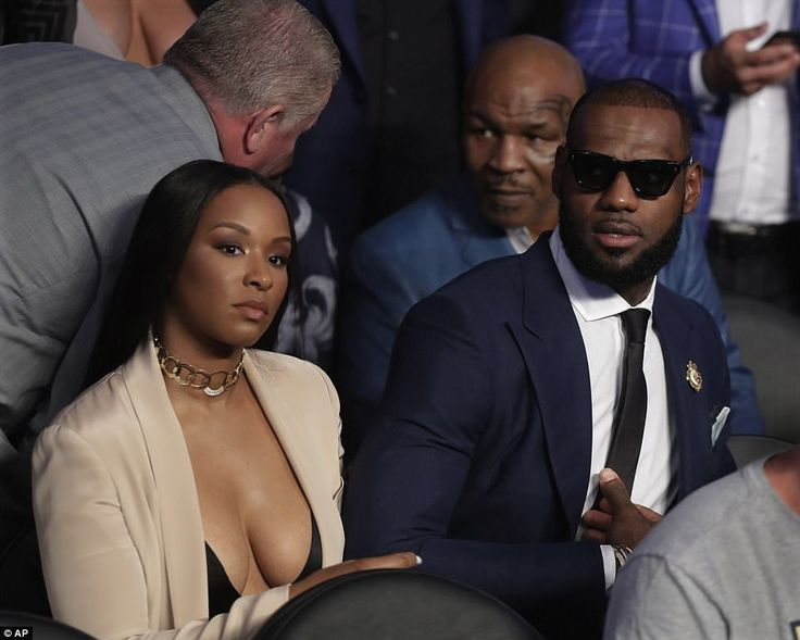 """""""When a man makes you his wife instead of his bitch."""" NBA star LeBron James (right) and former boxer Mike Tyson (second right) were among the familiar faces present at the bout"""